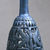 <em>Bottle with Openwork Shell</em>, ca. 1075-712 B.C.E. Egyptian blue, 6 11/16 x greatest diam. 2 15/16 in. (17 x 7.5 cm). Brooklyn Museum, Charles Edwin Wilbour Fund, 44.175. Creative Commons-BY (Photo: Brooklyn Museum, CUR.44.175_view5.jpg)
