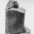 Egyptian. <em>Temple Block Statue of a Man Connected to the Estate of a God's Wife of Amun</em>, ca. 775-653 B.C.E. Diorite, 9 3/16 x 5 5/16 x 6 5/16 in. (23.4 x 13.5 x 16 cm). Brooklyn Museum, Charles Edwin Wilbour Fund, 64.200.1. Creative Commons-BY (Photo: , CUR.64.200.1_NegE_print_bw.jpg)
