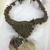 <em>Necklace with Pendant</em>. Shell, fiber, 4 5/16 × 5 13/16 in. (11 × 14.8 cm). Brooklyn Museum, Gift of Ingeborg de Beausacq, 64.248.41. Creative Commons-BY (Photo: , CUR.64.248.41.jpg)