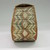 Woodlands. <em>Rounded Box with eight pointed star pattern</em>, late 19th century. Birchbark, porcupine quill, calico cloth, 5 1/2 × 6 3/4 × 3 5/8 in. (14 × 17.1 × 9.2 cm). Brooklyn Museum, Ella C. Woodward Memorial Fund, 68.98. Creative Commons-BY (Photo: , CUR.68.98_view02.jpg)