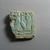 <em>Fragment of Pectoral</em>, ca. 1085-712 B.C.E. Faience, 2 1/8 × 2 1/16 × 1/2 in. (5.4 × 5.2 × 1.2 cm). Brooklyn Museum, Gift of Roger Khawam, 77.5. Creative Commons-BY (Photo: , CUR.77.5_view01.jpg)