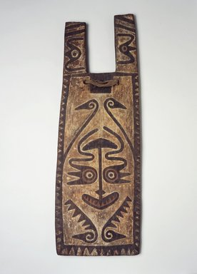 Possibly Elema. <em>Shield</em>, 19th century. Wood, fiber, pigment, 33 5/8 x 11 5/8 x 2 in. (85.4 x 29.5 x 5.1 cm). Brooklyn Museum, Brooklyn Museum Collection, 00.135. Creative Commons-BY (Photo: Brooklyn Museum, 00.135.jpg)