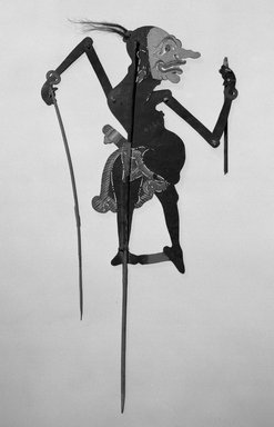 <em>Shadow Play Figure (Wayang kulit)</em>, before 1893. Leather, pigment, wood, fiber, hair, 20 11/16 × 9 5/8 in. (52.5 × 24.5 cm). Brooklyn Museum, Brooklyn Museum Collection, 00.155. Creative Commons-BY (Photo: Brooklyn Museum, 00.155_acetate_bw.jpg)