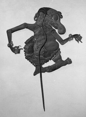 <em>Shadow Play Figure (Wayang kulit)</em>. Leather, pigment, wood, fiber, metal, 20 1/16 × 13 1/8 in. (51 × 33.3 cm). Brooklyn Museum, Brooklyn Museum Collection, 00.157. Creative Commons-BY (Photo: Brooklyn Museum, 00.157_acetate_bw.jpg)
