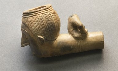 <em>Carved Pipe with Human Face on Bowl</em>. Light clay Brooklyn Museum, Brooklyn Museum Collection, 00.92. Creative Commons-BY (Photo: Brooklyn Museum, 00.92_side_PS10.jpg)