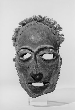 Tolai. <em>Lor Mask</em>, 19th century. Frontal bones of human skull, parinarium nut paste, clay, wood, human hair, fiber, pigment, 8 3/8 x 5 3/4 x 3 1/4 in. (21.3 x 14.6 x 8.3 cm). Brooklyn Museum, Gift of Dr. Clark Burnham, 01.1521. Creative Commons-BY (Photo: Brooklyn Museum, 01.1521_view1_acetate_bw.jpg)