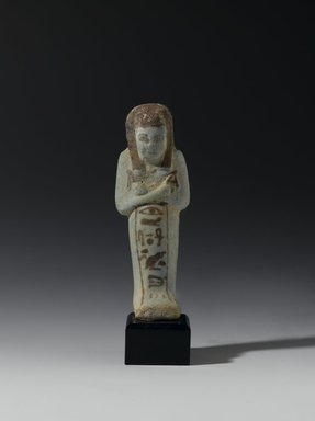 <em>Shabty of Ankhesenmut</em>, ca. 1075-945 B.C.E. Faience, 4 1/2 x 1 9/16 x 1 1/8 in. (11.5 x 4 x 2.8 cm). Brooklyn Museum, Anonymous gift, 02.222. Creative Commons-BY (Photo: Brooklyn Museum, 02.222_front_PS2.jpg)