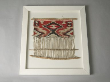 Navajo. <em>Model of Loom</em>, late 19th century. Wool, cotton, wood, image: 16 1/2 × 19 in. (41.9 × 48.3 cm). Brooklyn Museum, Gift of George Foster Peabody, 02.255.2253. Creative Commons-BY (Photo: Brooklyn Museum, 02.255.2253_PS5.jpg)