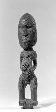 Maori (Rongowhakaata). <em>Gable Figure (Tekoteko)</em>, ca. 1850-1860. Wood, pāua shell, pigment, 12 3/8 x 2 1/2 x 2 in. (31.4 x 6.4 x 5.1 cm). Brooklyn Museum, Brooklyn Museum Collection, 03.216. Creative Commons-BY (Photo: Brooklyn Museum, 03.216_bw.jpg)