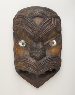 Maori. <em>Gable Mask (Koruru)</em>, ca. 1860. Wood, pāua shell, 19 7/8 x 10 3/4 x 1 7/8 in. (50.5 x 27.3 x 4.8 cm). Brooklyn Museum, Brooklyn Museum Collection, 03.217. Creative Commons-BY (Photo: Brooklyn Museum, 03.217_PS9.jpg)