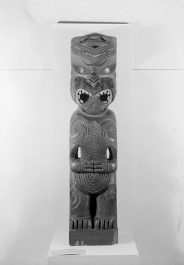 Maori. <em>Gable Finial  (Tekoteko)</em>, late 19th century. Wood, pāua shell, 49 1/4 x 11 1/2 x 8 1/2 in.  (125.1 x 29.2 x 21.6 cm). Brooklyn Museum, Purchased with funds given by A. Augustus Healy, Carll H. de Silver and Robert B. Woodward, 03.324.2785. Creative Commons-BY (Photo: Brooklyn Museum, 03.324.2785_acetate_bw.jpg)
