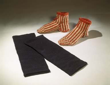 She-we-na (Zuni Pueblo). <em>Pair of Silversmith's Stockings (Ka-wu-sa-wai)</em>. Wool, (14 3/4 x 5 3/4 x 5 in. (37.0 x 13.5 cm). Brooklyn Museum, Museum Expedition 1903, Museum Collection Fund, 03.325.3550a-b. Creative Commons-BY (Photo: , 03.325.3366a-b_03.325.3550a-b_SL1.jpg)