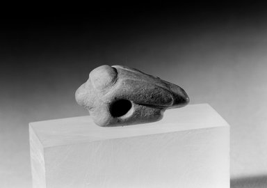 Ancient Pueblo (Anasazi). <em>Grey, Incised, Perforated Bird-shaped Charm</em>, 600-1300. Stone, 1 3/8 x 9/16 x 5/8 in. (3.5 x 1.4 x 1.6 cm). Brooklyn Museum, Museum Expedition 1903, Museum Collection Fund, 03.325.4455. Creative Commons-BY (Photo: Brooklyn Museum, 03.325.4455_acetate_bw.jpg)