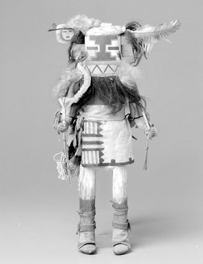 She-we-na (Zuni Pueblo). <em>Kachina Doll (Awethlu-ye-ya)</em>, late 19th century. Wood, hide, feather, fur, string, cloth, plant stems, 16 3/4 x 6 1/4 x 5 1/4 in. (42.5 x 15.9 x 13.3 cm). Brooklyn Museum, Museum Expedition 1903, Museum Collection Fund, 03.325.4610. Creative Commons-BY (Photo: Brooklyn Museum, 03.325.4610_bw.jpg)