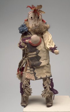 She-we-na (Zuni Pueblo). <em>Kachina Doll (Kjaklo)</em>, late 19th century. Wood, textile, leather, fur, feathers, pigment, shell, 14 1/2 x 6 x 4 1/4 in. (36.8 x 15.2 x 10.8 cm). Brooklyn Museum, Museum Expedition 1903, Museum Collection Fund, 03.325.4614. Creative Commons-BY (Photo: Brooklyn Museum, 03.325.4614.jpg)
