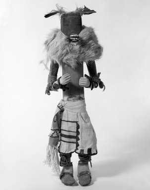 She-we-na (Zuni Pueblo). <em>Kachina Doll (Ahuta Shelowa)</em>, late 19th century. Feathers, fur, yarn, cloth, hide, wood, string, pigment, nails, (40.0 x 10.1 x 12.8 cm). Brooklyn Museum, Museum Expedition 1903, Museum Collection Fund, 03.325.4622. Creative Commons-BY (Photo: Brooklyn Museum, 03.325.4622_bw.jpg)