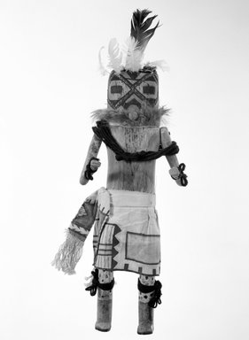 She-we-na (Zuni Pueblo). <em>Kachina Doll (U-hu-u)</em>, late 19th century. Fur, feathers, paint, cotton, yarn, cloth, wood, string, pigment, nails, 14 1/2 x 5 3/4 in. (36.8 x 14.6 cm). Brooklyn Museum, Museum Expedition 1903, Museum Collection Fund, 03.325.4624. Creative Commons-BY (Photo: Brooklyn Museum, 03.325.4624_bw.jpg)