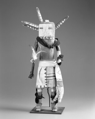 She-we-na (Zuni Pueblo). <em>Kachina Doll (Towitsinapa)</em>, late 19th century. Wood, cloth, yarn, string, feathers, hide, pigment, nails, metal, 17 5/16 x 4 3/4 x 6in. (44 x 12 x 15.2cm). Brooklyn Museum, Museum Expedition 1903, Museum Collection Fund, 03.325.4627. Creative Commons-BY (Photo: Brooklyn Museum, 03.325.4627_bw.jpg)
