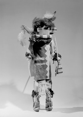 She-we-na (Zuni Pueblo). <em>Kachina Doll (Siatasha)</em>, late 19th century. Wood, leather, pigment, fabric, wool, feathers, string, 21 x 5 1/2 x 8 1/4 in. (53.3 x 14.0 x 21.0 cm). Brooklyn Museum, Museum Expedition 1903, Museum Collection Fund, 03.325.4630. Creative Commons-BY (Photo: Brooklyn Museum, 03.325.4630_acetate_bw.jpg)