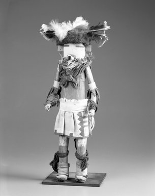 She-we-na (Zuni Pueblo). <em>Kachina Doll (Kanachu)</em>, late 19th century. Wood, fur, feathers, cotton, paint, wool, hide, paper, 15 1/2 x 3in. (39.4 x 7.6cm). Brooklyn Museum, Museum Expedition 1903, Museum Collection Fund, 03.325.4636. Creative Commons-BY (Photo: Brooklyn Museum, 03.325.4636_bw.jpg)