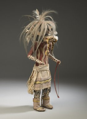 She-we-na (Zuni Pueblo). <em>Kachina Doll (Hilili Kohanna)</em>, late 19th century. Wood, pigment, horse hair, hide, cotton, feathers, tin, 20 x 6 1/2 x 5 1/2 in. (50.8 x 16.5 x 14 cm). Brooklyn Museum, Museum Expedition 1903, Museum Collection Fund, 03.325.4648. Creative Commons-BY (Photo: Brooklyn Museum, 03.325.4648_threequarter_PS6.jpg)