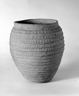 She-we-na (Zuni Pueblo) (Native American). <em>Corrugated Jar</em>. Clay, slip, 8 7/8 x 6 1/2 in. (22.5 x 16.5 cm). Brooklyn Museum, Museum Expedition 1903, Museum Collection Fund, 03.325.4731. Creative Commons-BY (Photo: Brooklyn Museum, 03.325.4731_bw.jpg)