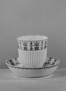 <em>Cup and Saucer</em>, ca. 1760. Decorated porcelain, Cup: 3 x 3 in. (7.6 x 7.6 cm). Brooklyn Museum, Gift of Reverend Alfred Duane Pell, 03.328.27a-b. Creative Commons-BY (Photo: Brooklyn Museum, 03.328.27a-b_acetate_bw.jpg)