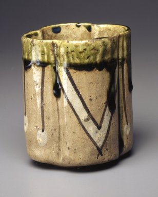 <em>Cup</em>, early 17th century. Mino ware in Oribe style: buff stoneware with iron-brown and white-slip painted designs under a clear glaze, top dipped in green glaze, 3 3/4 x 3 5/16 in.  (9.5 x 8.4 cm). Brooklyn Museum, Gift of Robert B. Woodward, 03.87. Creative Commons-BY (Photo: Brooklyn Museum, 03.87_SL4.jpg)