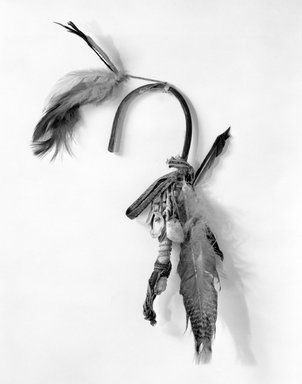 She-we-na (Zuni Pueblo). <em>Rattle (Chis-chi-nan-nai)</em>, 1801-1900, 19th century. Shell, pigment, wood, hide, rope, cloth, feathers, length: 10.0 in. (25.5 cm). Brooklyn Museum, Museum Expedition 1904, Museum Collection Fund, 04.297.5007. Creative Commons-BY (Photo: Brooklyn Museum, 04.297.5007_bw.jpg)
