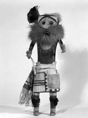 Mau-i (She-we-na (Zuni Pueblo)). <em>Kachina Doll (Kwalala)</em>, late 19th-early 20th century. Wood, fur, cotton, pigment, feathers, wool, 16 3/4 x 5 1/2 x 6 3/4 in. (42.5 x 14 x 17.1 cm). Brooklyn Museum, Museum Expedition 1904, Museum Collection Fund, 04.297.5353. Creative Commons-BY (Photo: Brooklyn Museum, 04.297.5353_bw.jpg)