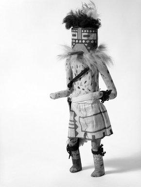 Mau-i (She-we-na (Zuni Pueblo)). <em>Kachina Doll (Thlum Pinto)</em>, late 19th-early 20th century. Wood, fur, feather, yarn, cotton, pigment, 14 1/2 x 5 1/2 x 5 3/4 in. (36.8 x 14 x 14.6 cm). Brooklyn Museum, Museum Expedition 1904, Museum Collection Fund, 04.297.5354. Creative Commons-BY (Photo: Brooklyn Museum, 04.297.5354_bw.jpg)