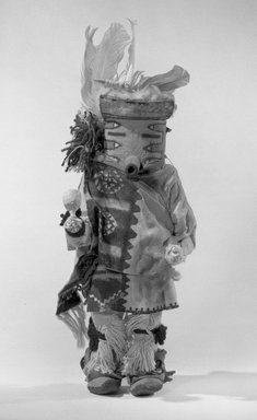 Mau-i (She-we-na (Zuni Pueblo)). <em>Kachina Doll (Ata Ona)</em>, late 19th-early 20th century. Wood, hide, cotton cloth, feathers, pigment, Height: 14 11/16 in. (37.3 cm). Brooklyn Museum, Museum Expedition 1904, Museum Collection Fund, 04.297.5357. Creative Commons-BY (Photo: Brooklyn Museum, 04.297.5357_acetate_bw.jpg)