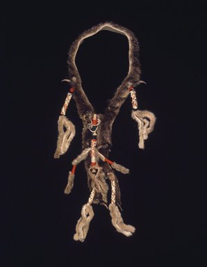 Navajo. <em>Collar with Whistle Worn in the Hashk'an Dance</em>, late 19th century. Hide, fur, sinew, claws, wool, quill, cotton, plant fiber, pigment, resinous material, 27 x 4 x 1.5 in. (71.0 x 9.5 cm). Brooklyn Museum, Museum Expedition 1904, Museum Collection Fund, 04.297.5430. Creative Commons-BY (Photo: Brooklyn Museum, 04.297.5430.jpg)