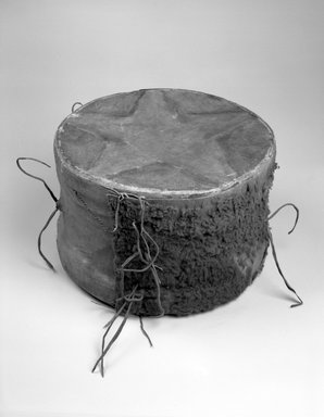Hochunk. <em>Buffalo Drum</em>, 19th century. Buffalo hide, rawhide, pigment, fur, 23 1/2 x 15 x 15 in. (59.7 x 38.1 x 38.1 cm). Brooklyn Museum, Museum Expedition 1904, Museum Collection Fund, 04.297.6952. Creative Commons-BY (Photo: Brooklyn Museum, 04.297.6952_bw.jpg)