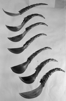 Haida. <em>Spoon (Slagwul) with Depiction of Killer Whale, Shaman and Land Otter</em>, 19th century. Horn, 10 5/8 x 1 11/16 x 1 in.  (27 x 4.3 x 2.5 cm). Brooklyn Museum, Museum Expedition 1905, Museum Collection Fund, 05.588.7422. Creative Commons-BY (Photo: , 05.252_05.304_05.588.7422_acetate_bw.jpg)