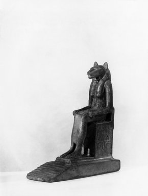 <em>Figure of Bast or Sekhmet Seated on a Throne</em>, 19th century C.E. Plaster, pigment, 6 1/2 x 5 1/8 x 2 in. (16.5 x 13 x 5.1 cm). Brooklyn Museum, Charles Edwin Wilbour Fund, 05.317. Creative Commons-BY (Photo: Brooklyn Museum, 05.317_threequarter_print_bw.jpg)