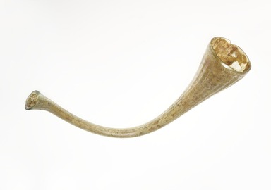 Roman. <em>Trumpet</em>, 4th-5th century C.E. Glass, 3 11/16 x 1 3/4 x 8 9/16 in. (9.3 x 4.4 x 21.7 cm). Brooklyn Museum, Gift of R. B. Woodward, 05.35. Creative Commons-BY (Photo: Brooklyn Museum, 05.35_PS4.jpg)