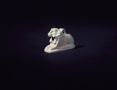 <em>Amulet of a Kneeling Ram</em>, ca. 664-332 B.C.E. Faience, glazed, 1 5/8 x 1/2 x 15/16 in. (4.1 x 1.2 x 2.4 cm). Brooklyn Museum, Charles Edwin Wilbour Fund, 05.378. Creative Commons-BY (Photo: Brooklyn Museum, 05.378_transp5441.jpg)