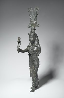 <em>Isis</em>, 1st century C.E. (probably). Bronze, 14 3/4 x 3 x 4 1/2 in. (37.5 x 7.6 x 11.4 cm). Brooklyn Museum, Charles Edwin Wilbour Fund, 05.395. Creative Commons-BY (Photo: Brooklyn Museum, 05.395_threequarter_left_PS2.jpg)