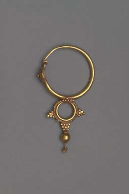 Coptic. <em>Earring with Pendant</em>, 6th century C.E. Gold, 1 13/16 x 15/16 x 1/4 in. (4.6 x 2.4 x 0.6 cm). Brooklyn Museum, Ella C. Woodward Memorial Fund, 05.438. Creative Commons-BY (Photo: Brooklyn Museum, 05.438.jpg)