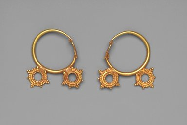 <em>Earrings with Two Wheel Ornaments</em>, 6th century C.E. Gold, .440a: 1 7/16 x 1 3/8 x 5/16 in. (3.7 x 3.5 x 0.8 cm). Brooklyn Museum, Ella C. Woodward Memorial Fund, 05.440a-b. Creative Commons-BY (Photo: Brooklyn Museum, 05.440a-b.jpg)