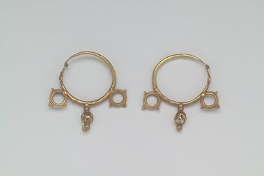 <em>Earrings with Wheel and Pendant Ornaments</em>, 6th century C.E. Gold, 1 3/4 x 1/4 in. (4.4 x 0.6 cm). Brooklyn Museum, Ella C. Woodward Memorial Fund, 05.441a-b. Creative Commons-BY (Photo: Brooklyn Museum, 05.441a-b.jpg)