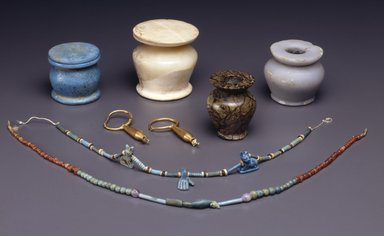 <em>Single-strand Necklace</em>, ca. 2008-1630 B.C.E. Faience, amethyst, carnelian, 15 3/4 in. (40 cm). Brooklyn Museum, Gift of the Egypt Exploration Society, 12.911.6. Creative Commons-BY (Photo: , 05.472.1-.2_12.911.6_48.66.41_58.78.2_37.647e_08.480.20a-b_14.609a-b_SL4.jpg)