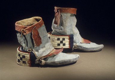 Hopi Pueblo. <em>Dancing Shoes</em>, late 19th century. Deer hide, pigments, sinew, porcupine quill, horse hair, wool, 10 3/16 x 4 5/16 x 7 5/16 in. (25.9 x 11 x 18.6 cm). Brooklyn Museum, Museum Expedition 1905, Museum Collection Fund, 05.588.7175a-b. Creative Commons-BY (Photo: Brooklyn Museum, 05.588.7175a-b.jpg)