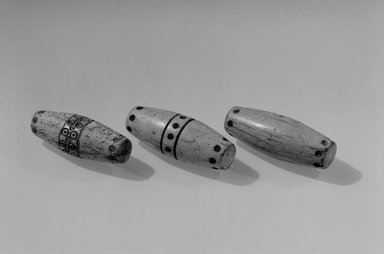 Gwa'sala Kwakwaka'wakw. <em>Pair of Hand-Game Bones</em>. Bone (whale?), pigment, 3 x 1 1/4 x 1 1/4 in. (7.6 x 3.2 x 3.2 cm). Brooklyn Museum, Museum Expedition 1905, Museum Collection Fund, 05.588.7288a-b. Creative Commons-BY (Photo: , 05.588.7287a_05.588.7288a-b_acetate_bw.jpg)
