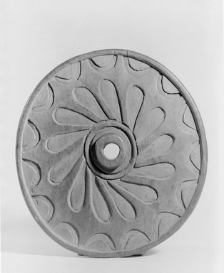 Chemainus, Coast Salish. <em>Spindle Whorl (Sulsultin) Carved with Wheel Design</em>, late 19th century. Cedar wood, 8 7/8 x 9 1/4 in. (22.5 x 23.5 cm). Brooklyn Museum, Museum Expedition 1905, Museum Collection Fund, 05.588.7384. Creative Commons-BY (Photo: Brooklyn Museum, 05.588.7384_acetate_bw.jpg)