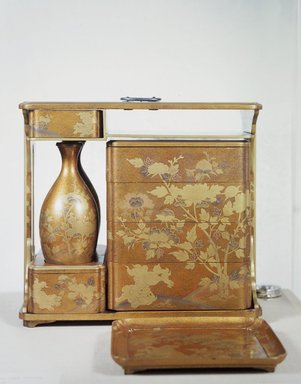 <em>Portable Picnic Set (sagejuu)</em>, second half 18th century. Powdered gold (aventurine) lacquer; hiramaki-e on a nashiji background, 13 11/16 x 8 3/8 x 14 15/16 in. (34.7 x 21.2 x 38 cm). Brooklyn Museum, Gift of Theodore E. Smith, 06.310. Creative Commons-BY (Photo: Brooklyn Museum, 06.310_transp4610.jpg)