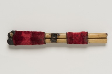Pomo. <em>Whistle (Li-bou)</em>. Bone, cotton, twine, 3 15/16 x 1/2in. (10 x 1.2cm). Brooklyn Museum, Museum Expedition 1906, Museum Collection Fund, 06.331.7953. Creative Commons-BY (Photo: Brooklyn Museum, 06.331.7953_view01_PS11.jpg)