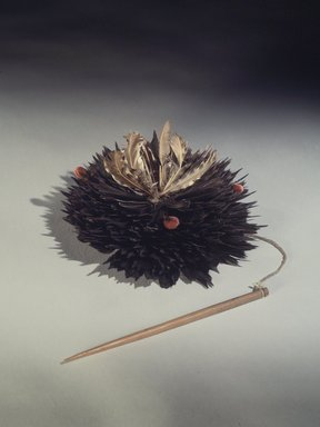 Pomo. <em>Headdress</em>, 19th century. Flicker feathers, cotton string, plant fibers, wool, wood pin, 5 x 8 1/4 in. (12.7 x 21 cm). Brooklyn Museum, Museum Expedition 1906, Museum Collection Fund, 06.331.8027d. Creative Commons-BY (Photo: Brooklyn Museum, 06.331.8027d.jpg)