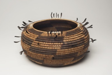Pomo. <em>Coiled Ceremonial Basket Bowl</em>. Willow, sedge root, bulrush root, acorn woodpecker scalp, feathers, valley quail topknot feathers, clamshell beads, cotton string, 4 1/2 × 11 3/4 × 11 7/8 in. (11.4 × 29.8 × 30.2 cm). Brooklyn Museum, Museum Expedition 1906, Museum Collection Fund, 06.331.8134. Creative Commons-BY (Photo: Brooklyn Museum, 06.331.8134_overall_PS11.jpg)